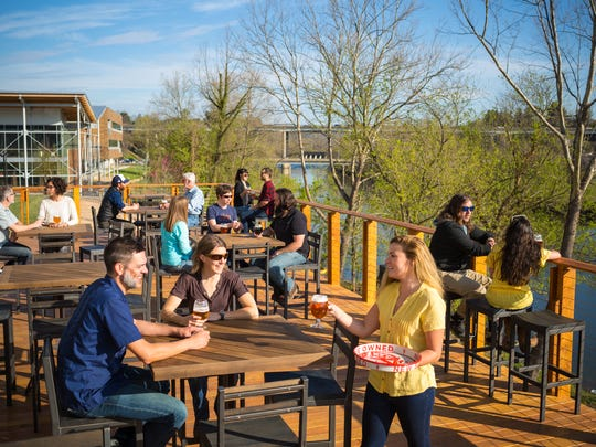 The patio at New Belgium Brewing   Liquid Center in West Asheville has a spectacular view of the French Broad River.
