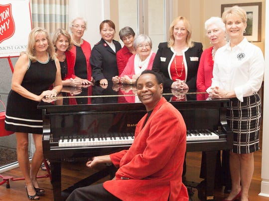 Jazz pianist Copeland Davis is the featured entertainer for this year's Wings of Hope Luncheon.  Pictured with Mr. Davis are Luncheon Committee members Beth Mistarz, Kim Johnson, Auxiliary President Murile Franz, Captain Christine Kim, Joan Smith, Rachel Malinowski, co-chair Carolyn Timmann, Pat Northcutt, and co-chair Vicki Davis.