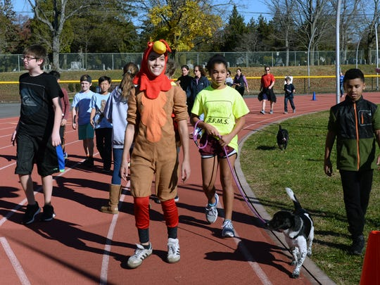 Ridgewood, NJ 11/18/16  Benjamin Franklin Middle School Students and their pets walk the track earn turkeys to donate to Social Services for their Thanksgiving Meals. Benjamin Franklin MS pledged to donate one turkey for every 50 laps run by all participants.