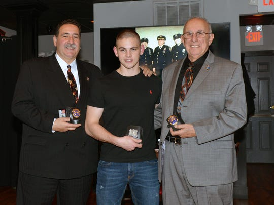Three generations of Port Authority police officers, from left:  Frank Farfalla Jr., Nick Farfalla and Frank Farfalla Sr.  at Nick Farfalla's graduation party.