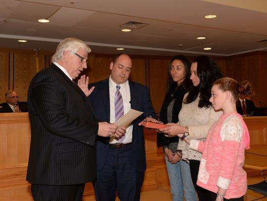 Councilman David May taking the oath from Mahwah Mayor