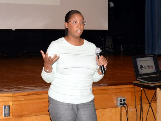 """Jasmin McCloud, mental health professional, speaking about suicide prevention at the """"Just Talk About It"""" forum."""