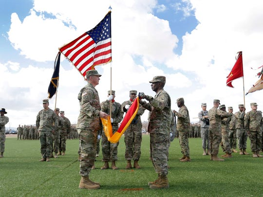 The 1st Brigade command team of Col. Eric S. Strong and Command Sgt. Maj. Eugene Russell cased the colors on Jan. 6, signifying that the brigade will soon deploy.