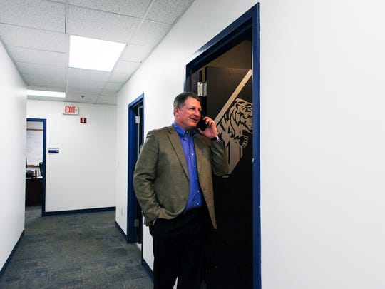 """Chris Ball, defensive coordinator, congratulates a new football recruit during National Signing Day in the Athletic Office Building at University of Memphis on Wednesday, Feb. 1, 2017. """"You're a part of the best recruiting class ever in Memphis,"""" Ball told the player."""