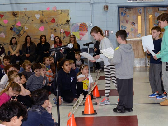 """Ridgewood 02/16/17 Black History Month celebration at Orchard School. theme this year is """"Hidden Figures""""  Student reading biorgraphies of people they studied."""