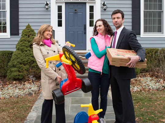 """In John Cariani's """"cul-de-Sac,"""" Diane Johnson (Molly Renfroe Katz), left to right, accidentally runs over the next door neighbors' Big Wheels and buys the Joneses (Katie Hartke and Michael Borrelli) some new ones. Directed by Michael Schiralli, the production is running at Half Moon Theatre at The Culinary Institute of America on weekends April 29-May 14."""