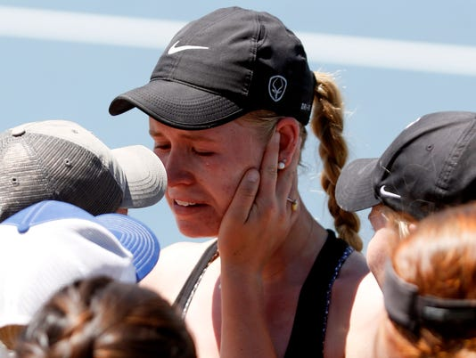 Shedding a tear of joy, Poudre High School's Ky Ecton is surrounded by friends and fans after going the distance in a three-set match May 13 at Gates Tennis Center in Denver, CO. Ecton defeated Anshika Singh in the Class 5A No. 1 singles state title match