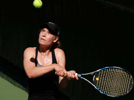 Ky Ecton keeps her eye on the ball while preparing to hit a backhand to Anshika Singh during their three-set match May 5 at Gates Tennis Center in Denver, CO. Ecton defeated Singh in the Class 5A No. 1 singles state title match, 7-6 (13-11), 4-6, 6-4.Photo by Philip B. Poston