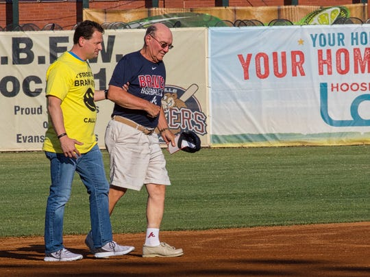 Stroke survivor (and baseball/Atlanta Braves enthusiast) Richard Tepool arrived via helicopter and threw out the first pitch at last year's Strike Out Stroke game. He was escorted to the pitcher's mound by Deaconess neurohospitalist Dr. Jason Meckler.