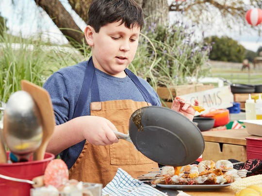 Contestant Daniel Marcus of Cherry Hill makes his second dish, Daniel's Crazy Clam Bake, as seen on the Food Network's Kids BBQ Championship, Season 2.