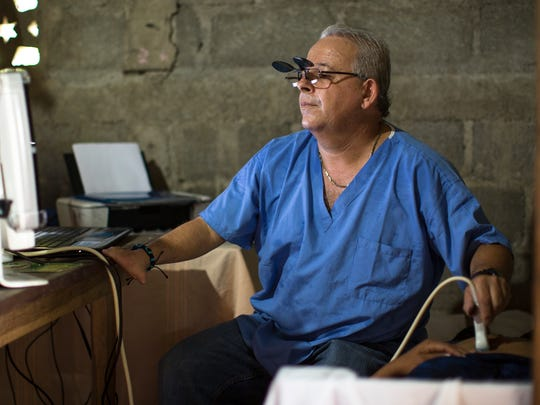 Dr. Candido Calderius Rios uses a portable ultrasound machine to see the position of a woman's unborn baby. Dr. Candido, as he is known, joined the Rainbow Network staff in 2007 and has found faith and fulfilment in his work.