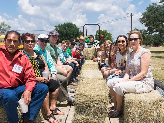 Visitors and alumni enjoyed hayrides, giving a tour
