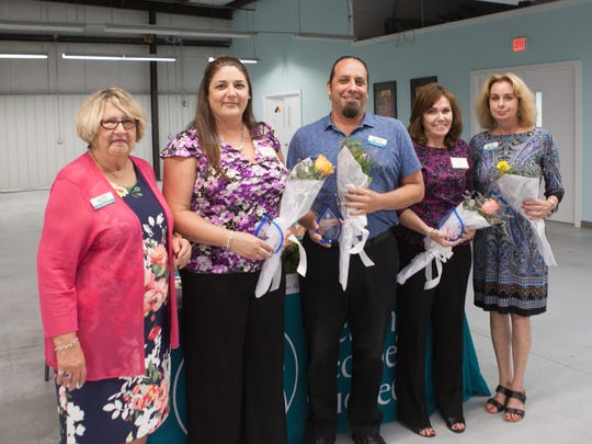 Suzy Hutcheson, Kelly Cuevas, Ken Dannewitz, Deb Tasy, Glenna Parris at Helping People Succeed's Annual Meeting. Cuevas, Dannewitz, Tasy and Parris were recognized for their contributions in moving to the group's new offices.