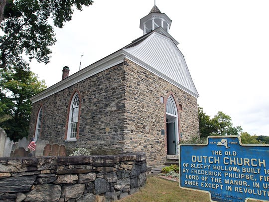 Halloween is big business in Sleepy Hollow, New York, where the Old Dutch Church and cemetery are the site of tours.
