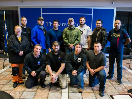 A group of veterans who are also OTC students posed for a photo at the Veterans Day event Friday.