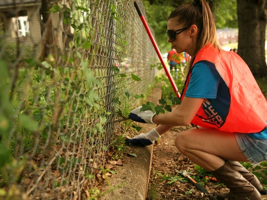 Hands On Greenville is another of the United Way's biggest annual initiatives. In April 2016, Emerald Clark cleared weeds in Monaghan, one of 160 HOG projects that day.