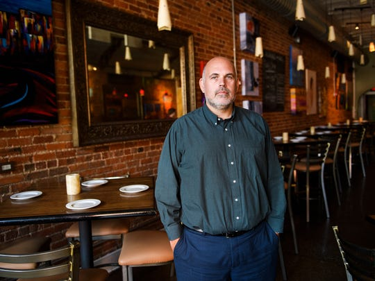 Jeff Gossett, owner of SELECT restaurant, poses for