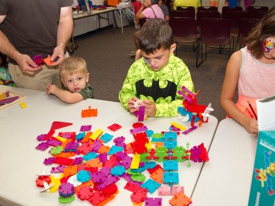 At the Library Summer Reading Party in Midland Park, kids create their own structures.