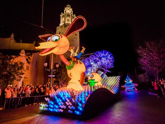 """Slinky the Dog dominates the """"Toy Story"""" float in the Paint the Night Parade at California Adventure."""