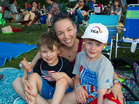 A family comes out to see fireworks in North Jersey.
