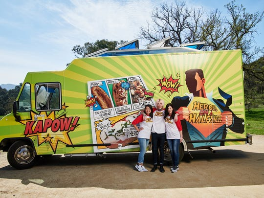 """The Heroes on a Half Shell food truck team (Danni, Clinton and Donna Sheron) in front of their truck, as seen on """"The Great Food Truck Race,"""" Season 9."""