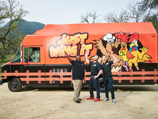 """The Just Wing It food truck team (Steven Crowley, Sharon Shvarzman, Kevin Pettice) in front of their truck, as seen on """"The Great Food Truck Race,"""" Season 9."""