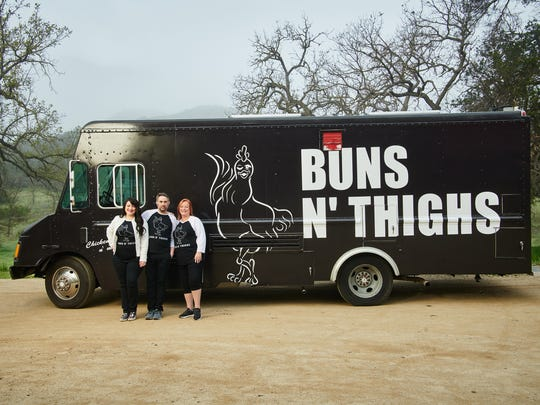 """The Buns N' Thighs food truck team (Victoria Nones, Ian Sherwin, Maria Nones) in front of their truck, as seen on """"The Great Food Truck Race,"""" Season 9."""