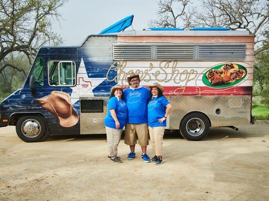 "The Chops' Shop food truck team (Sonia Buckelew, Bryan Soliz, Sandra Soliz) in front of their truck, as seen on ""The Great Food Truck Race,"" Season 9."