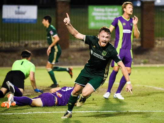 Greenville FC's Garrett Bridgewater (17) celebrates after scoring a goal against the New Orleans Jesters on Wednesday, June 27, 2018. The strike tied the game up late in the match, galvanizing the crowd, before New Orleans nabbed a winning goal right before time expired.
