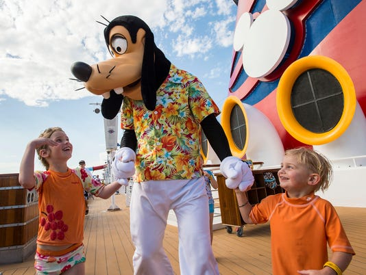 Goofy with Guests on the Disney Magic