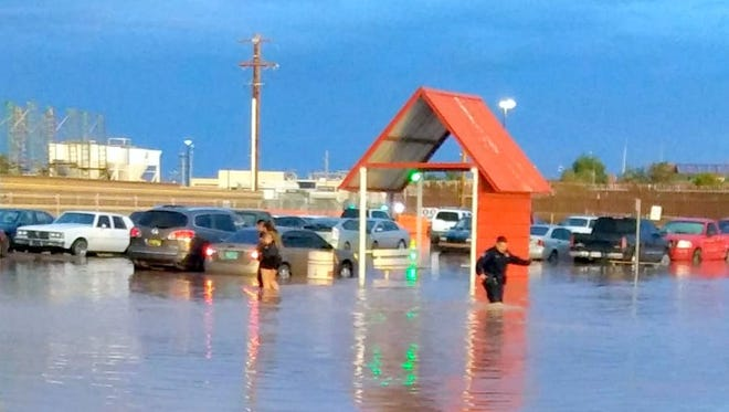 Heavy rainfall flooded a parking area near the U.S.Port of Entry south of Columbus, NM on Sunday.