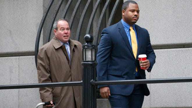 William Porter, right, one of six Baltimore city police officers charged in connection to the death of Freddie Gray, arrives at a courthouse with his attorney Joseph Murtha for jury selection in his trial Monday in Baltimore.