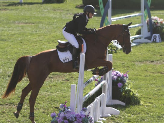 Riders and horses compete in the annual American Gold