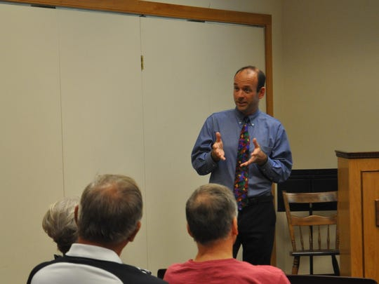 Cayuga Medical Associates Dr. John-Paul Mead spoke at the Ulysses Philomathic Library on Thursday night about his experiences fighting this year's Ebola outbreak in West Africa.