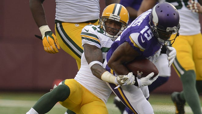Green Bay Packers cornerback Sam Shields (37) tackles Minnesota Vikings receiver Greg Jennings (15) in the third quarter during Sunday's game at TCF Bank Stadium on the campus of the University of Minnesota in Minneapolis. Evan Siegle/Press-Gazette Media