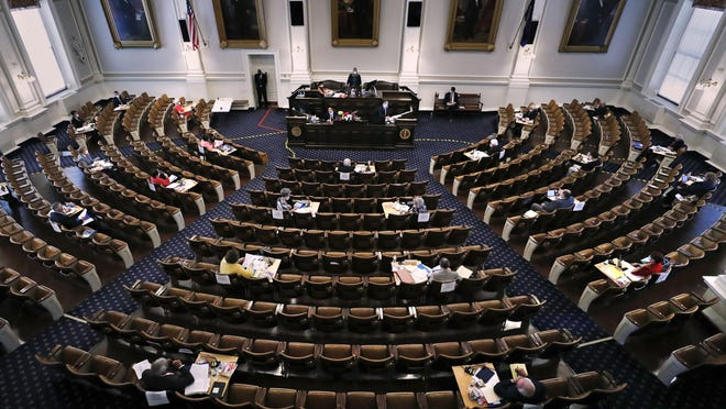 Members of the N.H. Senate gather for a session on Tuesday, June 16, 2020 at the State House in Concord, New Hampshire. The 24 N.H. Senators met in the N.H. House Chamber while adhering to social distancing rules due to the COVID-19 virus outbreak. [AP photo/Charles Krupa]