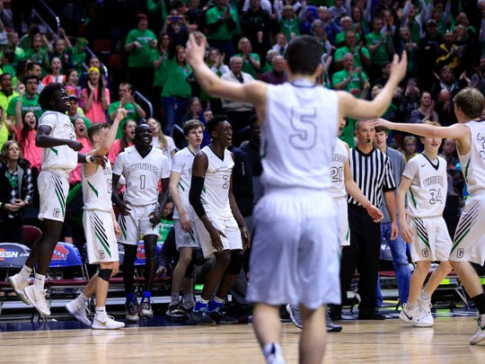 Grand View Christian players celebrate a win during
