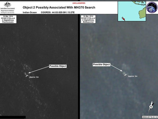 """This combo of handout images taken on March 16, 2014 and released on March 20, 2014 by the Australian Government's Department of Defence via the Australian Maritime Safety Authority show satelite images of objects in the Indian Ocean which may be from missing Malaysia Airlines flight MH370 which disappeared en route to Beijing early on March 8.  Australia said on March 20 that the two objects -- the largest estimated at 24 metres (79 feet) long -- spotted in the Indian Ocean were the """"best lead we have"""" in the search for the missing Malaysian passenger jet.      AFP PHOTO/Australian Government's Department of Defence via the Australian Maritime Safety Authority"""