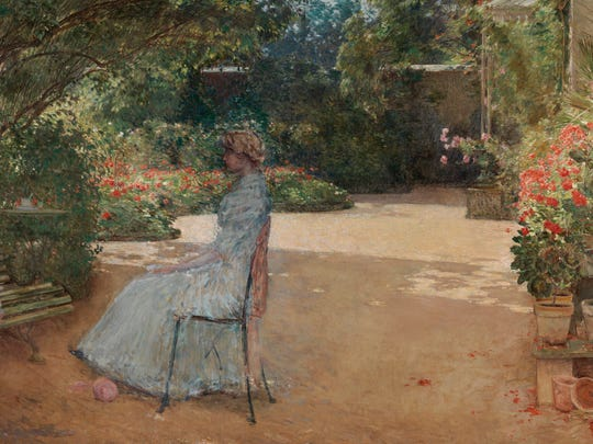 Childe Hassam (1859-1935) painted 'The Artist's Wife in a Garden, Villiers-le-Bel' in 1889.