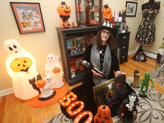 Donna Davies, the self-proclaimed Queen of Halloween, in her Halloween Room at her Hyde Park home Oct. 3, 2017.
