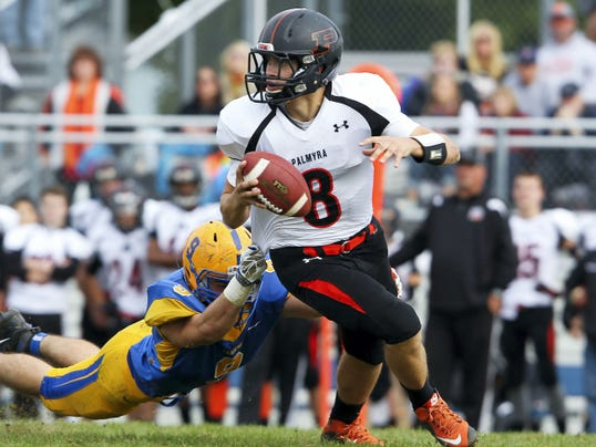 Tyler Gallagher, of Palmyra, looks to pass during their 49-13 loss to Middletown on Saturday, October 24, 2015.