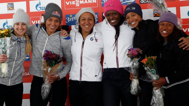 USA women took gold and tied for silver at a World Cup bobsled event on Saturday in Park City, Utah. Track star Lolo Jones (second from left) earned a silver and is making the selection process interesting.
