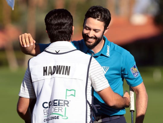 Adam Hadwin hugs his caddie on 18 at the La Quinta Country Club during the 3rd round of the CareerBuilder Challenge on Saturday, January 21, 2017. He finished the day at 17 under.