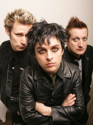 Green Day (left to right) bassist Mike Dirnt, singer and guitarist Billie Joe Armstrong and drummer Tre Cool,