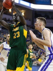 Deng Geu #23 of North Dakota State looks to score over Dylan Carl #11 of Fort Wayne at the 2018 Summit League Basketball tournament at the Denny Sanford Premier Center in Sioux Falls. (Photo by Dick Carlson/Inertia)