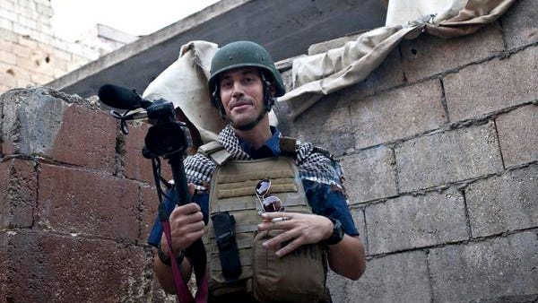 In this November 2012, file photo, posted on the website freejamesfoley.org, shows American journalist James Foley while covering the civil war in Aleppo, Syria. In a horrifying act of revenge for U.S. airstrikes in northern Iraq, militants with the Islamic State extremist group have beheaded Foley ? and are threatening to kill another hostage, U.S. officials say.