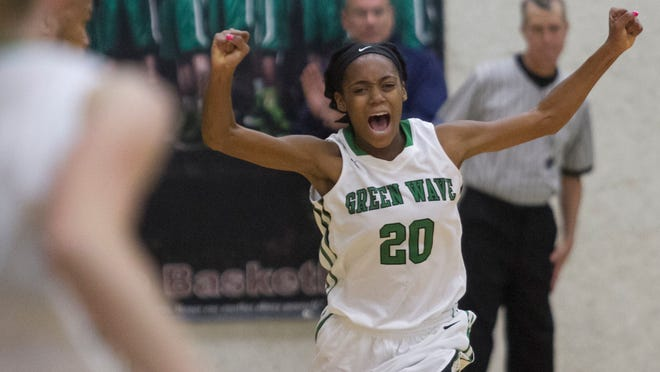 Larissa Roker of Fort Myers celebrates after the Green Wave beat Lakewood Ranch 55-51 in the girls regional basketball finals on Saturday, February 14, 2015, at Fort Myers High School.