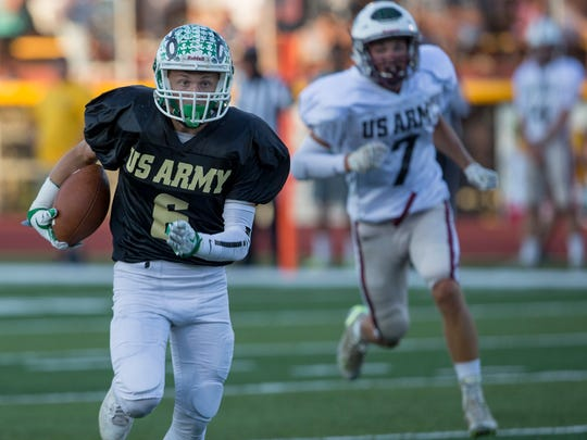 Ocean's Matt Schliefer caught a long pass and turns upfield to run into endzone for first touchdown of game. Monmouth County and  Ocean County Football squads in 39th Annual U.S. Army All-Shore Gridiron Classic.