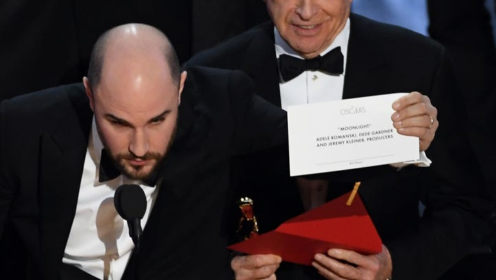 \'La La Land' producer Jordan Horowitz (L) holds up