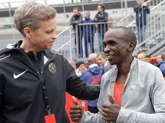 Olympic marathon champion Eliud Kipchoge talks with